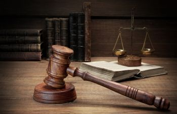 Judge Gavel, Scales of Justice and legal books on the desk