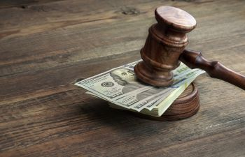 judge gavel on a pile of banknotes